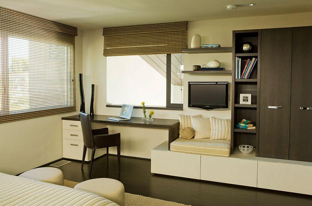 Modalitate de integrare a locului de birou in ansamblul mobilierului din living. Locul de sub smart tv este pentru catelul sau pisica familiei :) Foto Horst Architects
