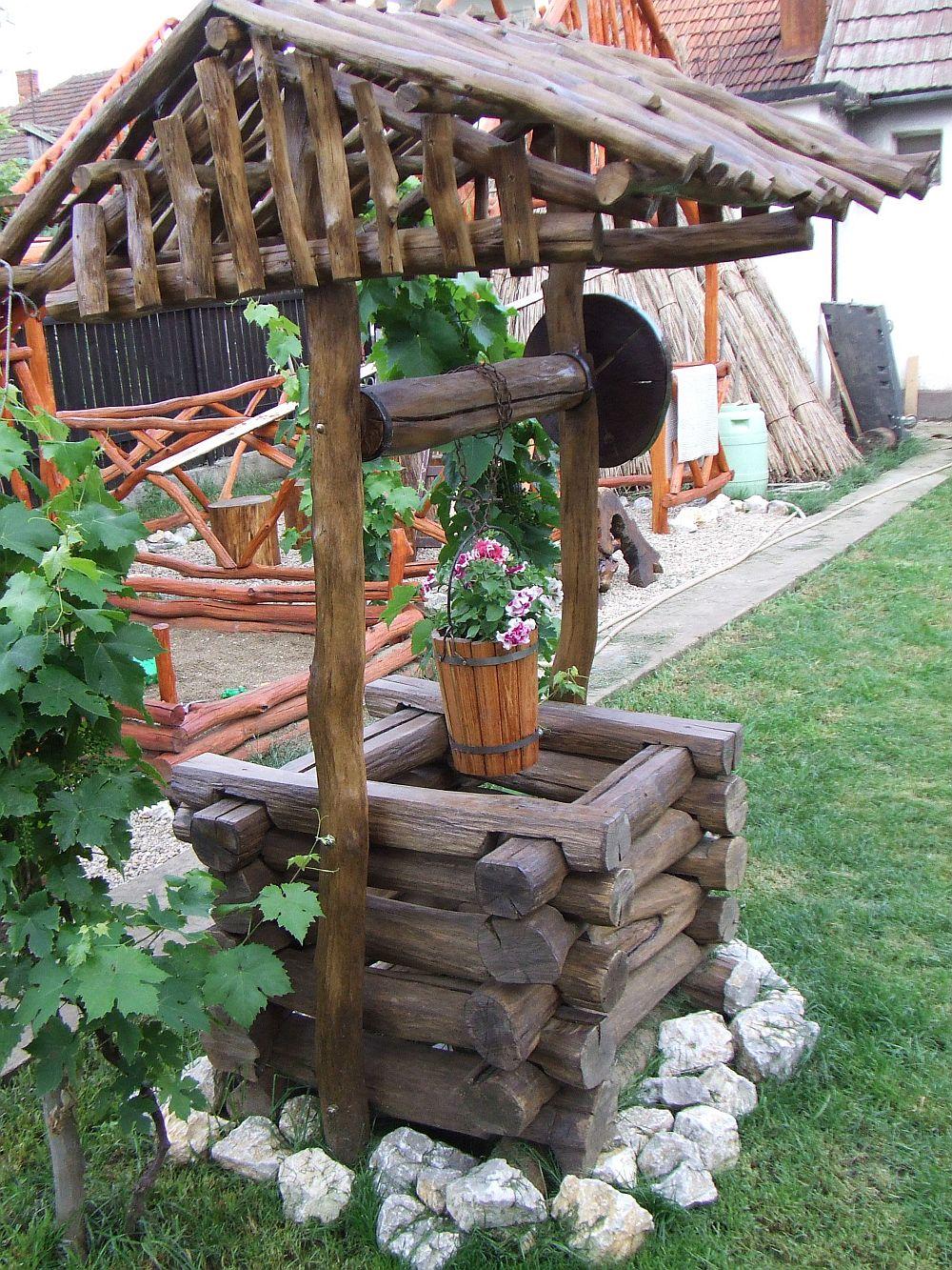 adelaparvu.com despre fantani decorative din lemn, masti pentru fantani, design Rustic Design, oradea (10)
