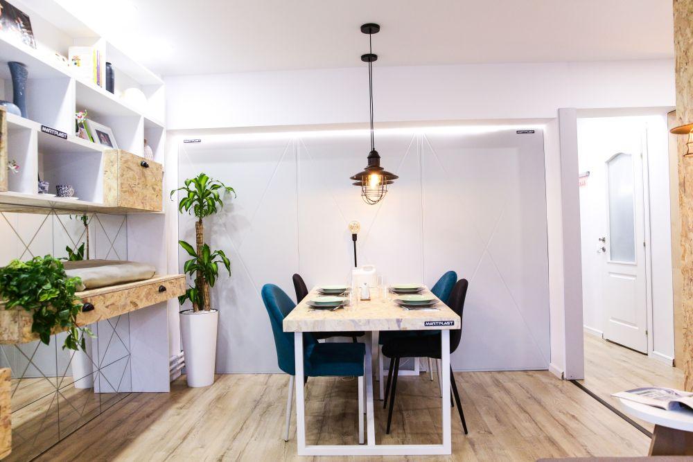Locul de masă este gândit aproape de bucătărie.