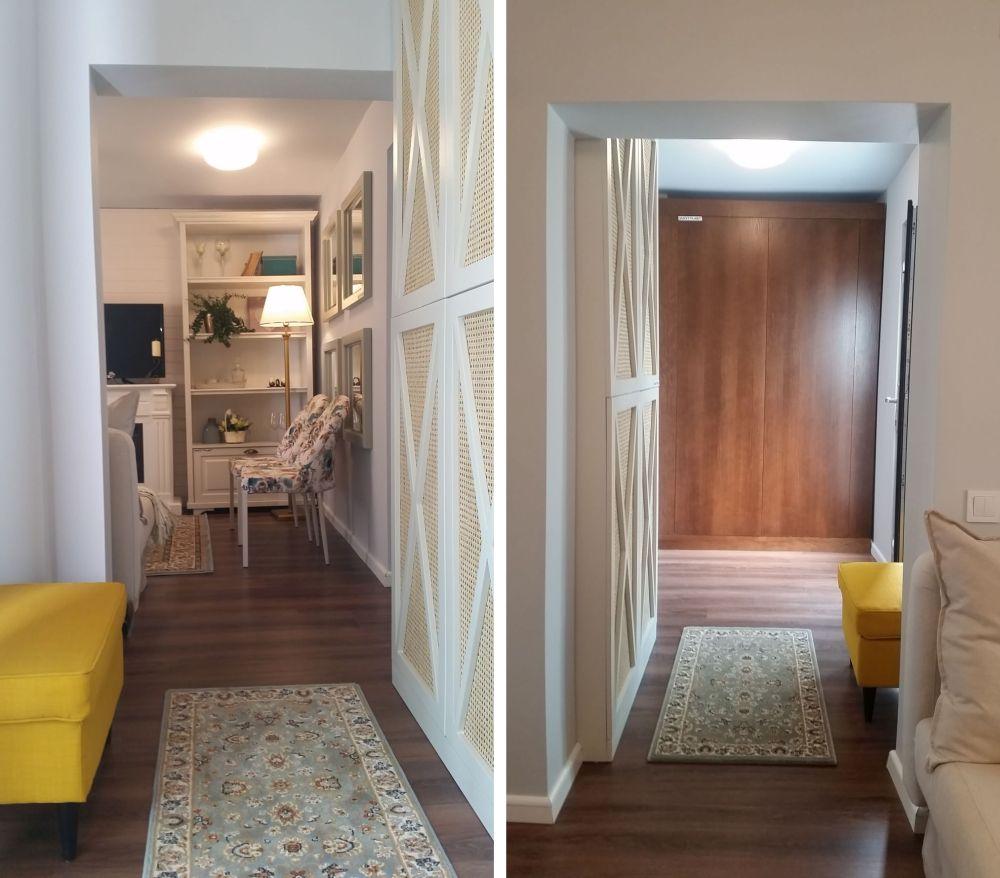 Holul după renovare a fost lăsat deschis către living. După ușa de la intrarea în casă este un dulap, iar un alt dulap maschează caloriferul din zonă și servește ca și cuier.