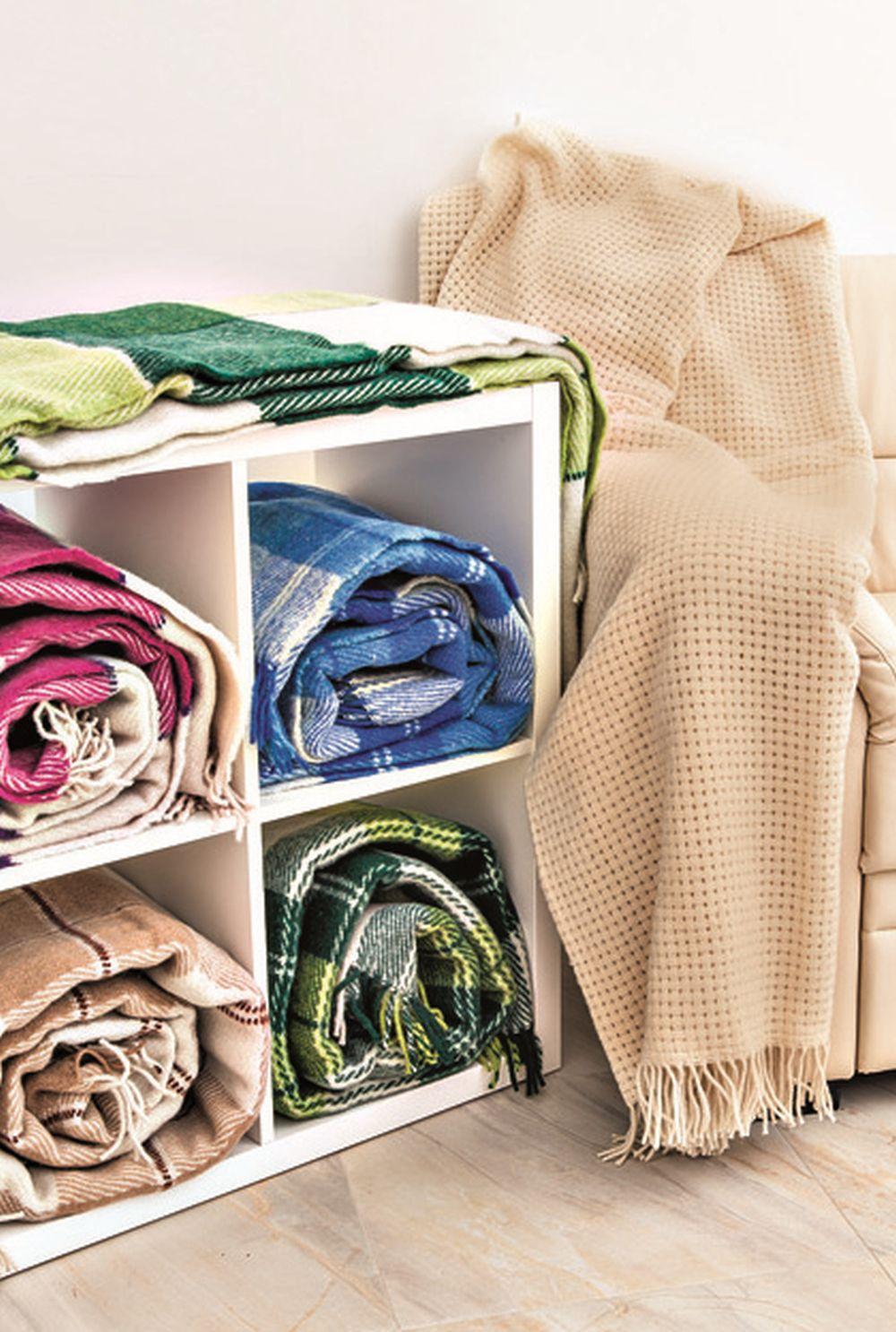 Pături cu compoziție din lână, călduroase pe timpul ierii, fac parte și ele din gama TEX.