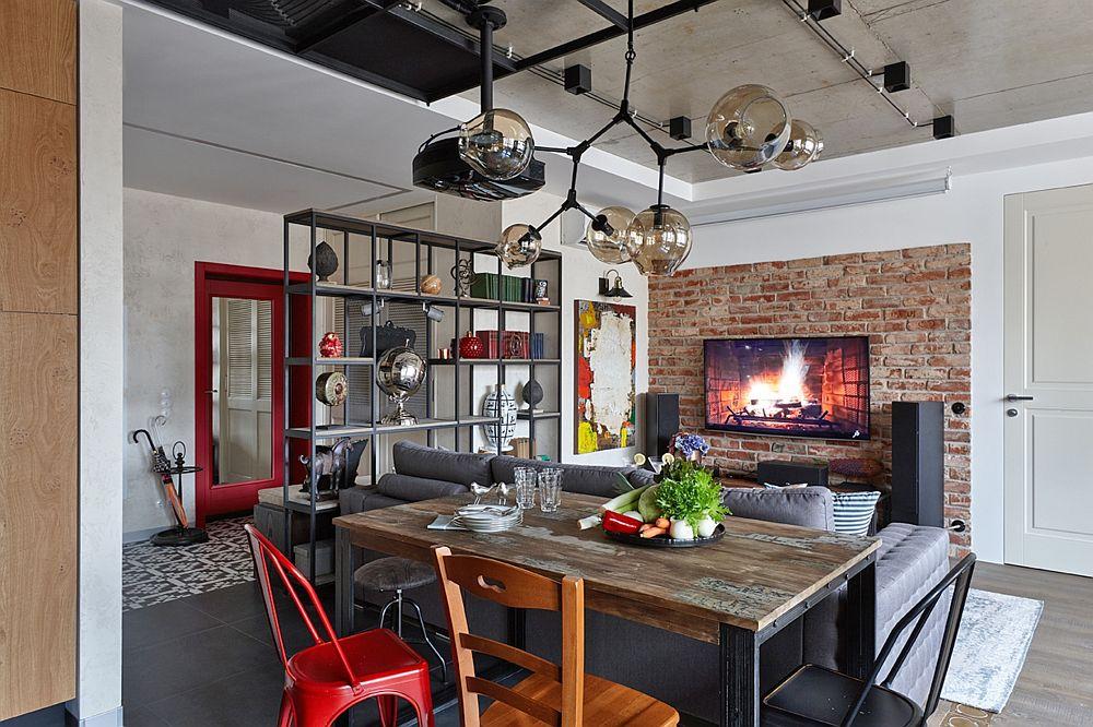 Spațiul livingului este clar sesizabil prin modul de așezare și orientare al mobilierului. De asemenea peretele pe care este fixat televizorul este finisat cu cărămidă aparentă cu aspect antichizat. De rea=marcat ușa de la intrare în apartament care are pe interior finisaj într-o nuanță vivace de roșu și fața decorată cu o oglindă.