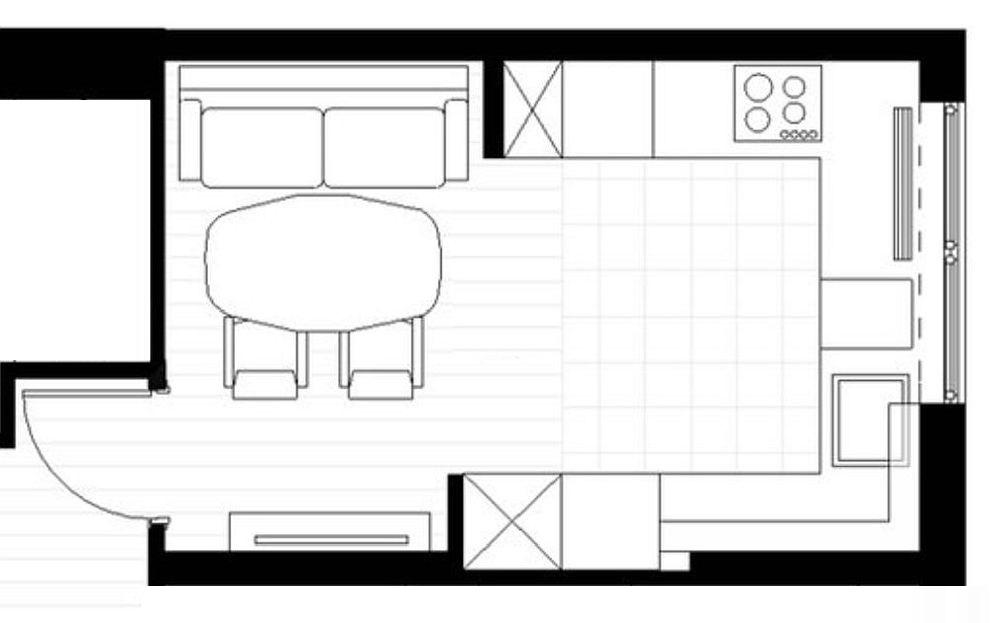 Toată partea de bucătărie a fost grupată către fereastră, iar locul pentru zona de zi restrâns în vecinătatea intrării în cameră. Astfel, centrul spațiului a rămas liber pentru activitățile din bucătărie, iar pe lângă zona de masă există spațiu de circulație în încăpere.