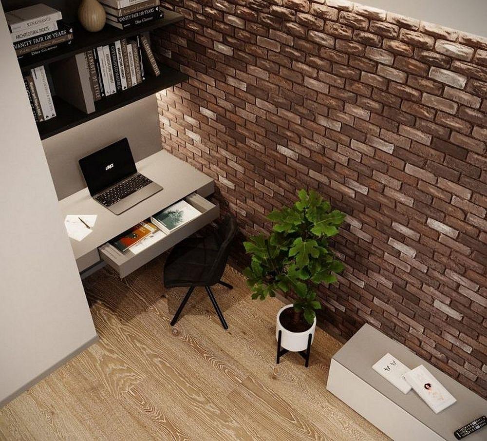 Masa biroului este una suspendată, dar ea ascunde un generos sertar. Iluminatul din zonă a fost gândit pentru a suplini necesarul de lumină naturală, având în vedere că poziția biroului este opusă ferestrei.