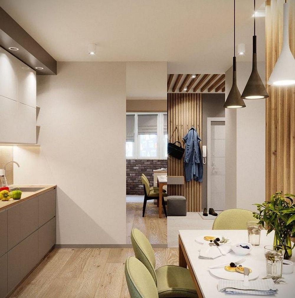 La intrarea în cameră, înspre bucătărie, designerii au prevăzut o oglindă care dă impresia de mai mult spațiu și mai multă lumină.