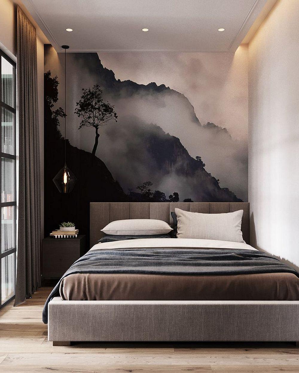 Pentru a configura un loc de pat dublu într-un spațiu mic, designerii au fost nevoiți la un compromis: patul să fie la perete, iar doar pe o parte să existe loc de noptiere. Având însă în vedere și situația în care dormitorul nu este camuflat prin draperie, designerii au prevăzut un fototapet grafic, care se vede frumos și dinspre zona de canapea.