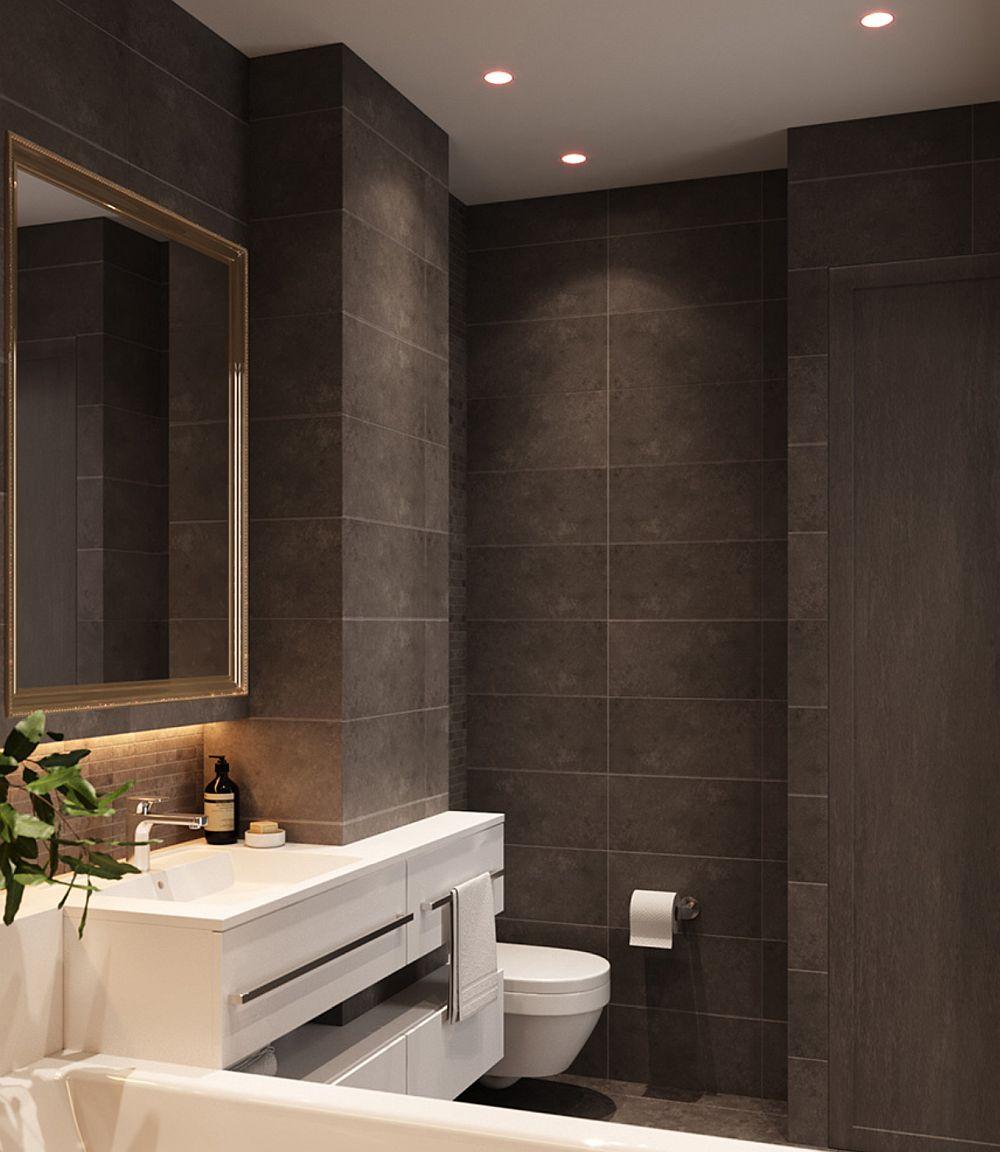 În dreapta intrării în baie există un dulap încastrat în perete care maschează locul mașinii de spplat rufe și al uscătorului, lăsând baia în rest să apară ca o încăpere elegantă.