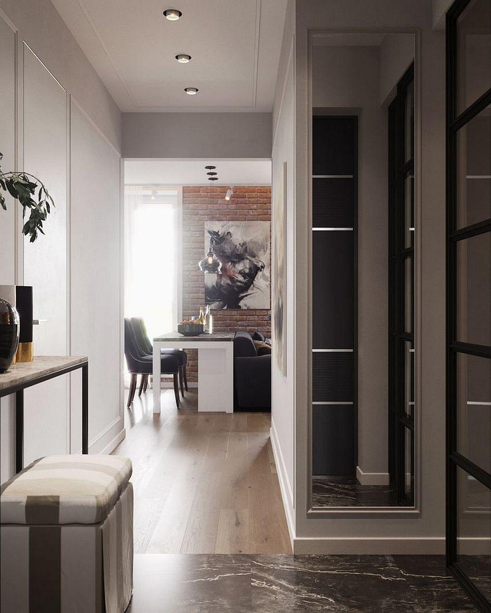 Imagine din ușa de la intrare de unde se vede holul care se deschide către living.