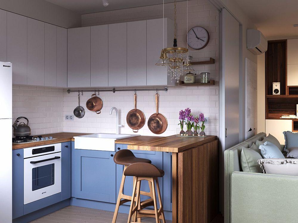 Mobila bucătăriei a fost proiectată de către arhitecți și realizată pe comandă după schițele lor. Deși nu este la vedere, în acest spațiu mic este mascată mașina de spălat rufe.