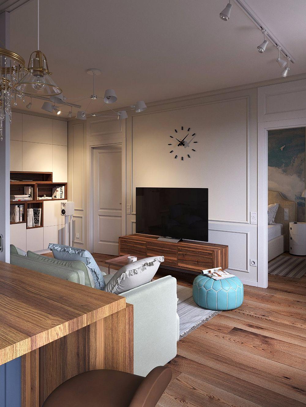 Dinspre bucătărie se pot observa cele două uși de acces către dormitor. Între ele este poziționat televizorul. Organizarea simetrică ordonează spațiul.