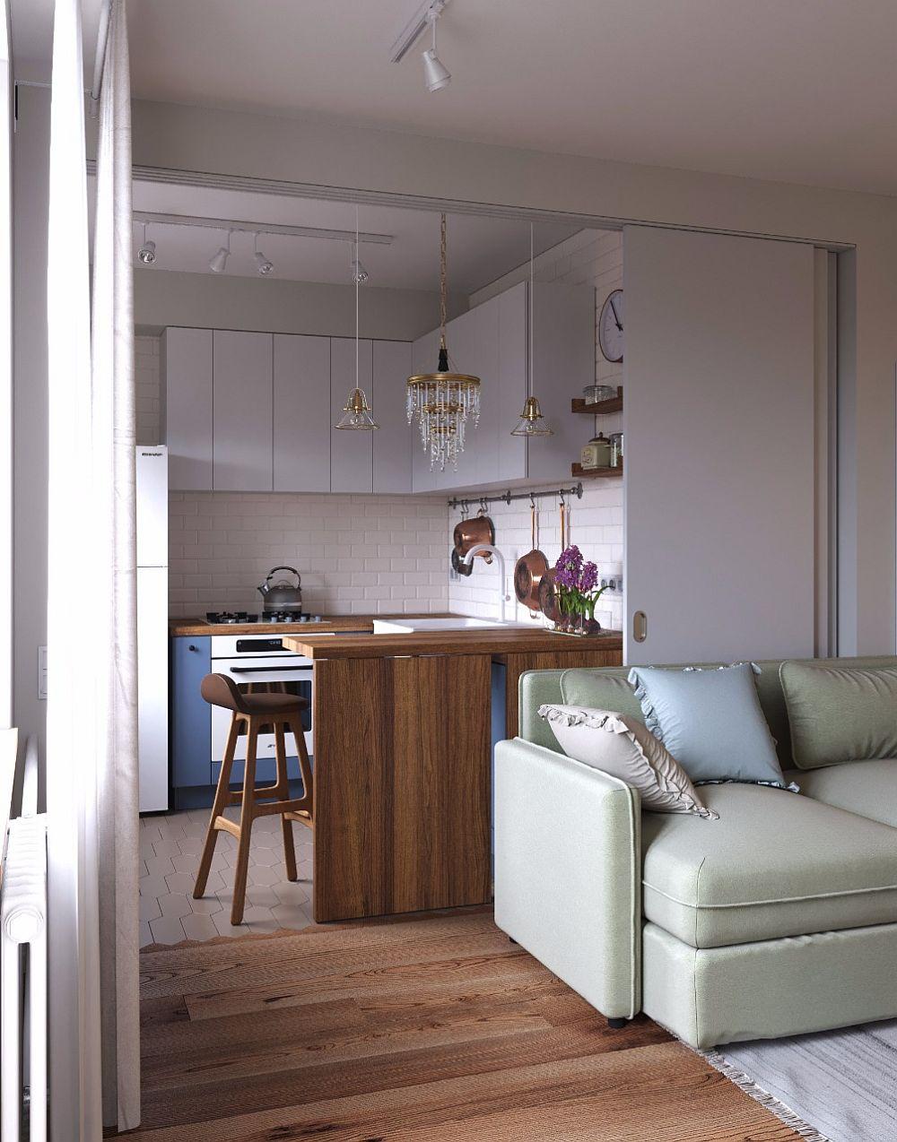 Bucătăria poate fi separată cu ajutorul unor uși culisante, care odată închise apar ca un perete în spatele canapelei. În bucătărie pardoseala este finisată cu aceleași plăci ceramice de la Equipe Ceramicas care se găsesc în holul de la intrare.