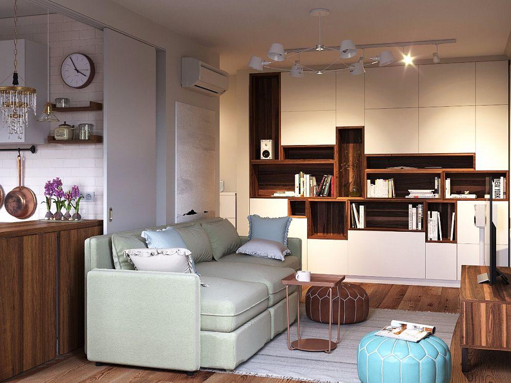 Pe unul dintre pereții livingului este creat un ansamblu de depozitare gândit de către arhitecți și realizat pe comandă după schițele lor.