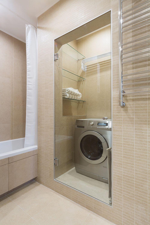 În baia mare designerii au gândit un loc pentru mașină de spălat și pentru uscarea rufelor, separat cu uși din sticlă.