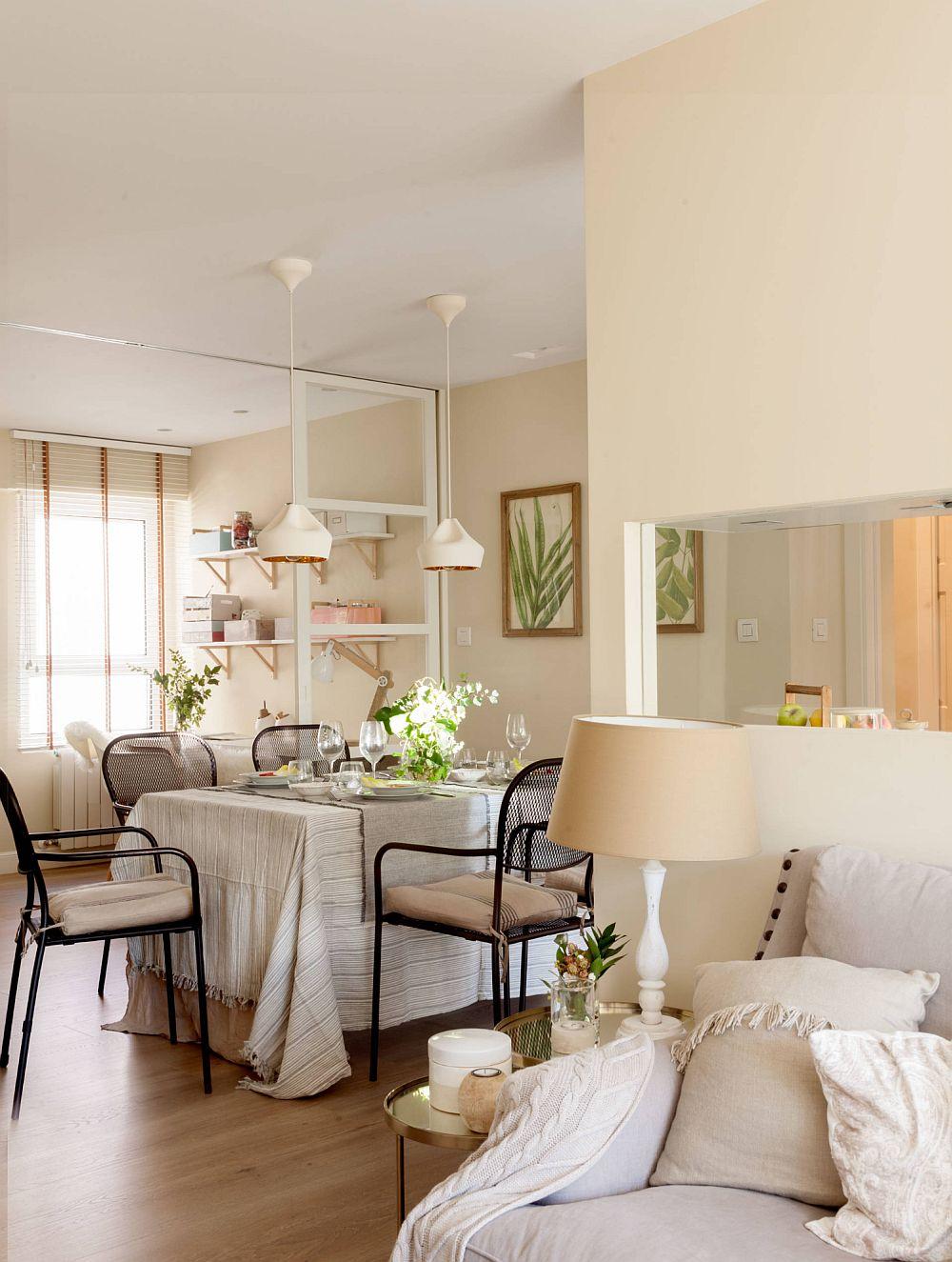 Locul de luat masa este situat în centrul locuinței. Designerul a prevăzut această poziționare în condițiile în care pereții de compartimentare au fost desființați, iar lumina naturală ajunge din ambele laturi ale locuinței către locul de luat masa.