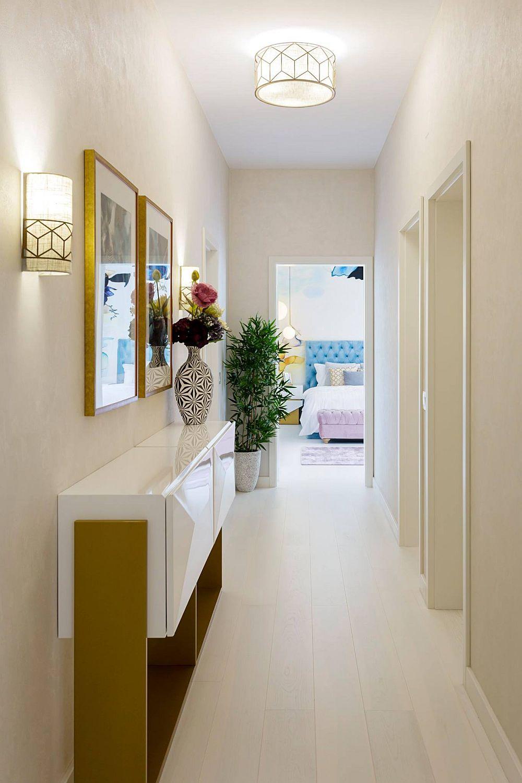 În atmosfera locuinței contează mult suprafețele deschise, cum e și parchetul alb de la Barlinek achiziționat prin Top Casa Oradea. Se simte acest lucru chiar și într-un spațiu lung și îngust cum e holul către dormitoare.