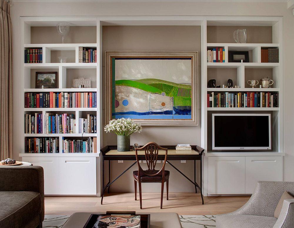 Îți poți dori un loc de birou aproape de biblioteca din living. Ce faci cu televizorul? Ei bine îl poți amplasa într-unul dintre corpuri. Dacă ai un tablou de impact deasupra mesei de birou atenția va fi asupra lui și nu asupra televizorului.