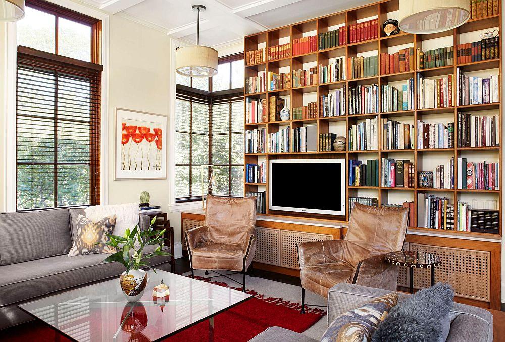 Biblioteca poate fi și un element de separare al spațiilor, inclusiv pentru scara interioară sau pentru delimitarea livingului față de hol.