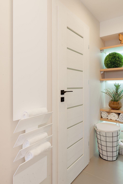 Și caloriferul din baie este unul cu design deosebit achiziționat prin DHD Amenajări Interioare.