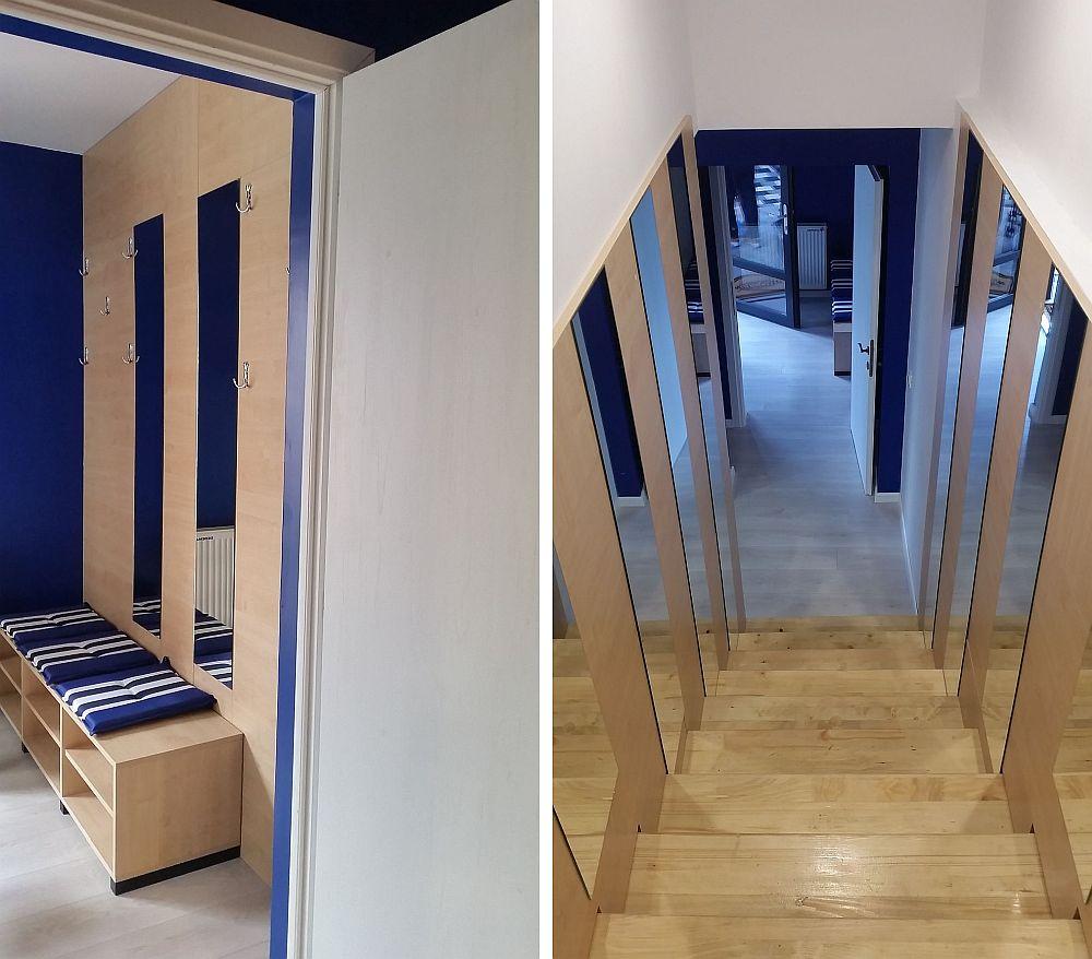 Holul de la intrare este un spațiu mic, delimitat cu ușă față de restul casei. Din hol se accede în living, dar și către scara interioară. Mobilarea din hol este minimală și funcțională. Pereții au fost placați cu PAL, inserate două oglinzi, iar suporturile pentru haine sunt prinse direct de placări. O banchetă cu rafturi pentru pantofi este situată sub oglinzi.