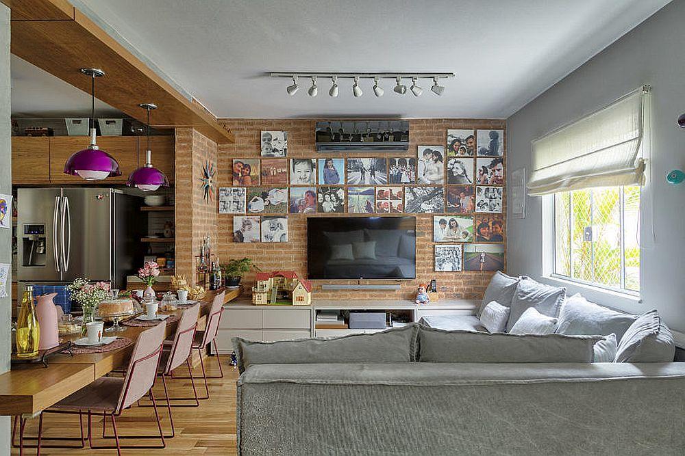 În același spațiu al parterului coexistă camera de zi, sufrageria, bucătăria și locul de birou, care este și loc de joacă pentru fetițe.