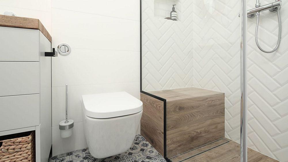 Cabina de duș este separată prin panouri din sticlă marcate pe margine cu finisaj metalic negru, care conturează interesant zona. La interiorul cabinei de duș s-a dorit un loc de ședere fix.