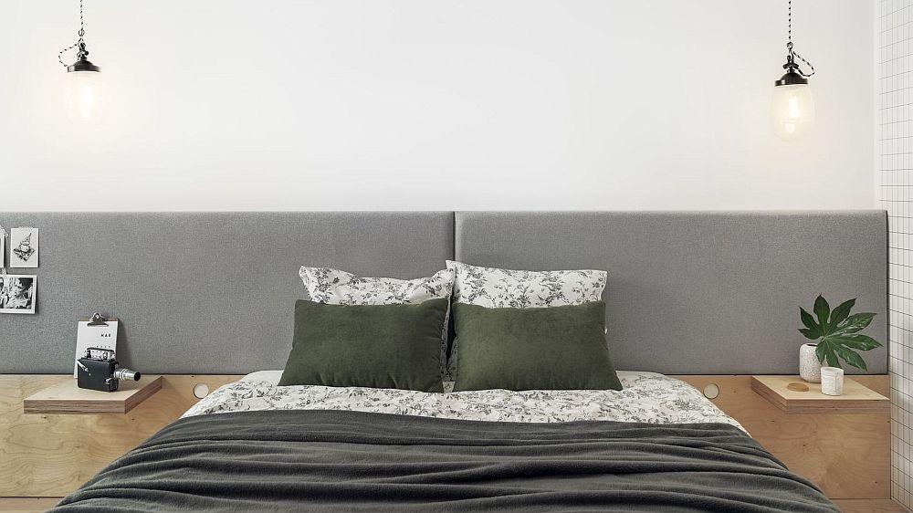 Zona de pat este marcată prin tăblia tapițată, dar și prin corpurile de iluminat suspendate de o parte și de alta a patului. În loul noptierelor sunt configurate mici polițe.