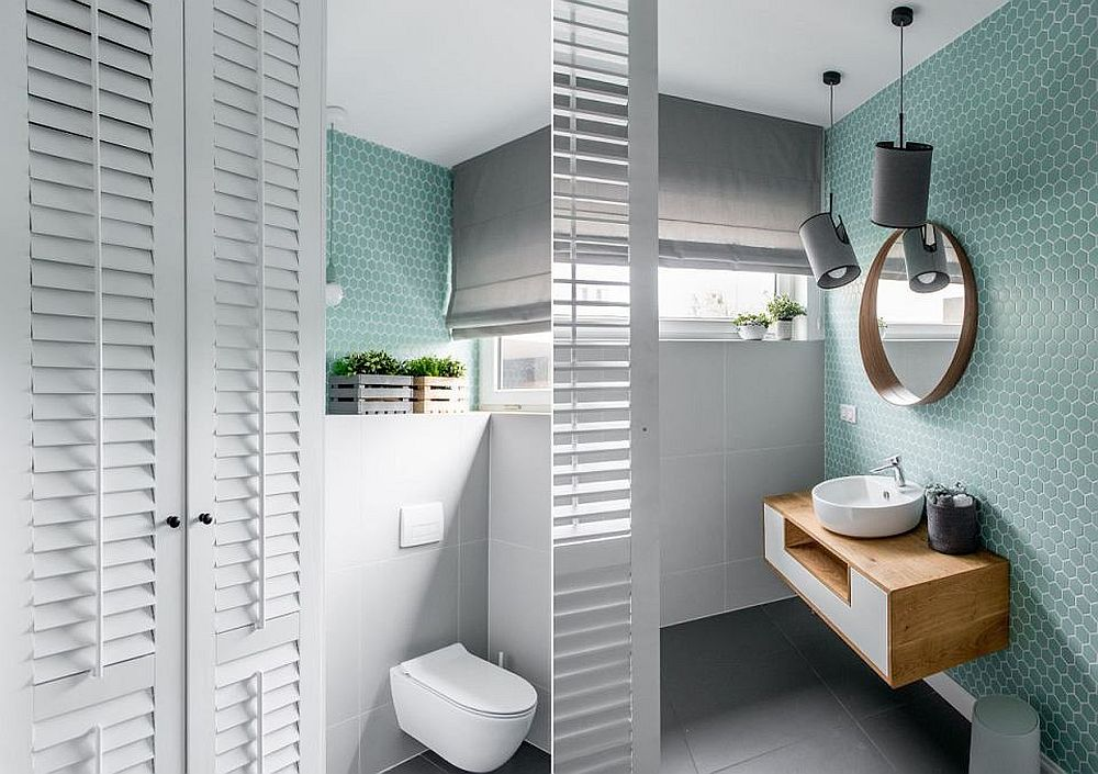 Una dintre băile casei este mai spațioasă, ea fiind și locul este sunt mascate mașina de spălat și uscătorul în ansamblul unor dulapuri cu uși lamelare.