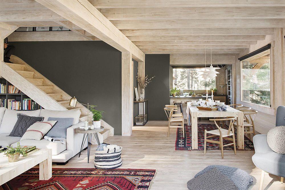Din holul casei se ajunge în zona de sufragerie care este deschisă către bucătărie și către living. Practic un parter open-space pe unde lumina naturală pătrunde din plin și odată cu ea ferestree devin adevărate tablouri vii, căci lasă pădurea să pătrundă la interior.