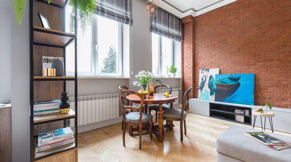 Spațiul liber al camerei s-a dorit pentru amplasarea unei mese, care este folosită și pentru lucru, nu doar pentru servitul preparatelor culinare.