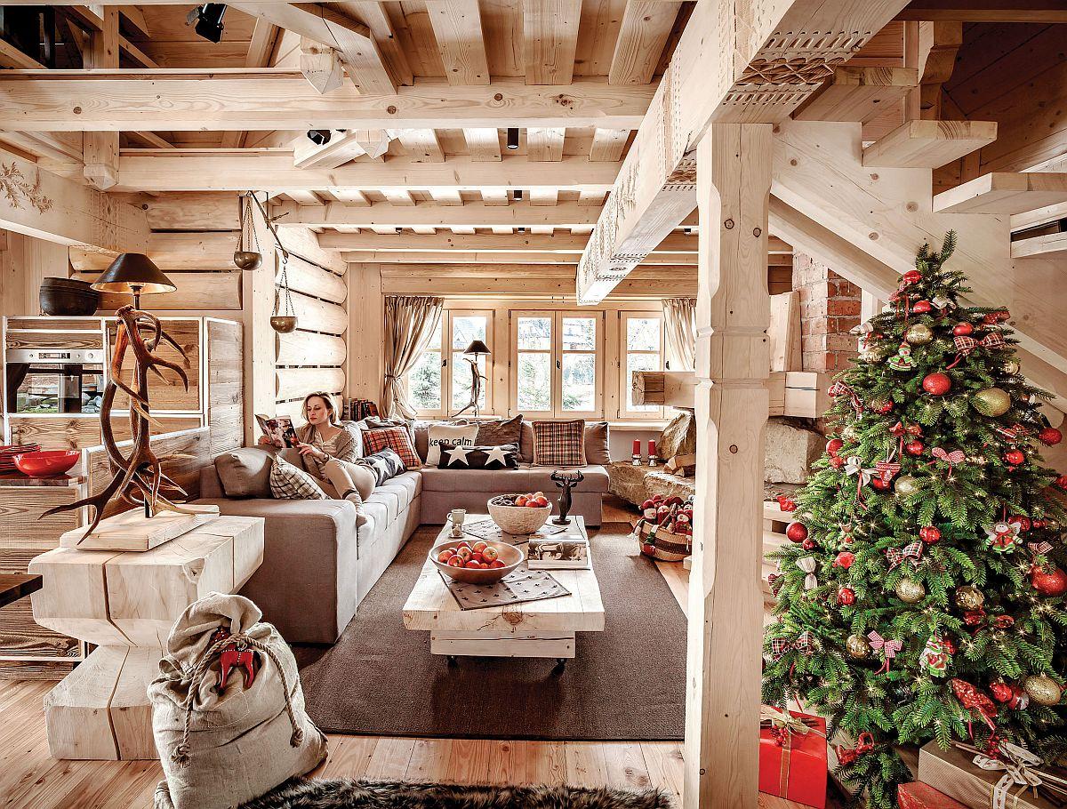 Ferestre generoase contribuie din plin la starea de bine resimțită în cabană fiind ca niște oaze deschise către exterior ce lasă loc lemnului să respire, dar și detaliilor să poată fi observate.