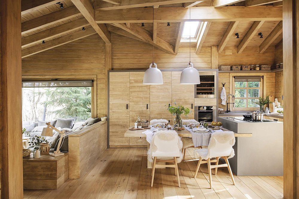 Zona de zi cuprinde în același spațiu livingul, sufrageria și bucătăria. Fiind o casă de vacanță, unde socializarea este principala activitate, e firesc ca spațiul bucătăriei să fie unul generos, iar funcțiunile să comunice între ele.