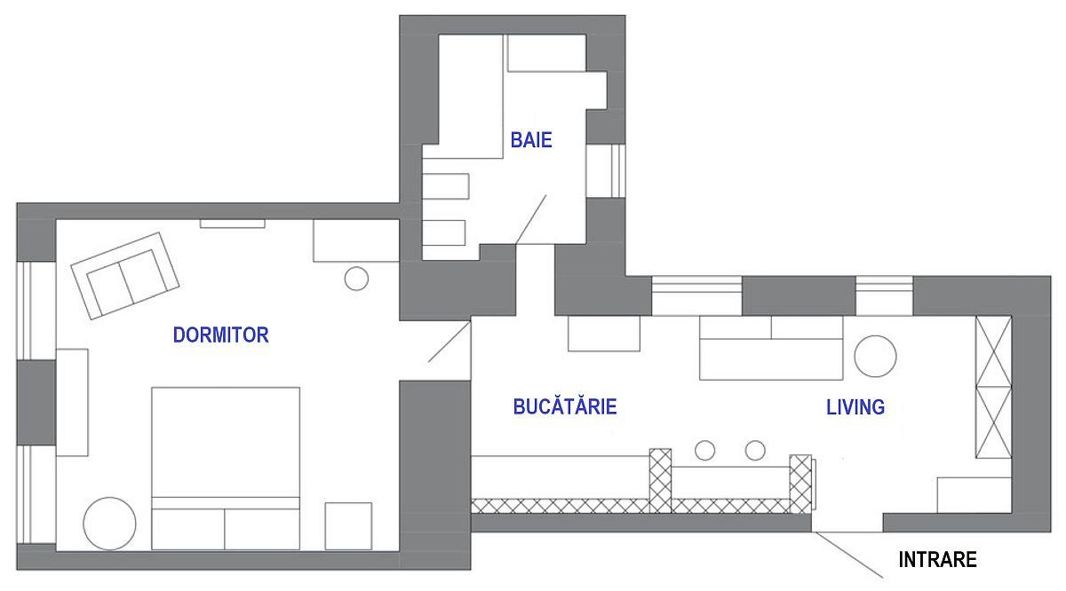 Întrarea în locuință se face din dreptul zonei de zi. Ceea ce a salvat cumva amenajarea a fost lățimea holului de circa 3 metri, ferestre înalte care lasă lumina să pătrundă din plin la interior, iar spațiul să nu fie sufocat, de asemenea și înplțimea camerelor, care au circa 3,1 metri pe verticală. Designerul Marina Chernova a folosit spațiul holului pentru a-l împărți între zonă de cuier, spațiu de depozitare, loc pentru canapea, loc de masă și bucătărie.
