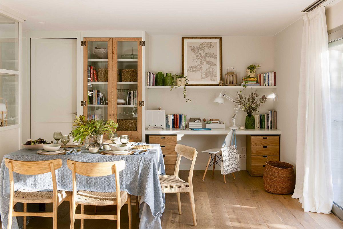 De partaea opusă bibliotecii și canapelei din living este zona de birou și vitrina corespondentă sufrageriei. Designerul a prevăzut aici o combinație între suprafețe albe și texturi din lemn pentru a creiona stilul actual cu accente rustice.