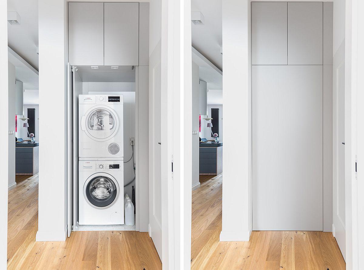 Pentru ca imaginea băilor să fie cât mai aerisită și elegantă, locul mașinii de spălat și al uscătorului a fost prevăzut pe hol, în vecinătatea uneia dintre băi. Aparatele electrocasnice sunt mascate de uși, iar deasupra lor mai există extra loc de depozitare pentru lucruri mai rar folosite. Un apartament actual, funcțional, dar și plăcut estetic, unde spațiile de depozitare generoase asigură loc suficient pentru miile de lucruri care se strâng într-o casă. Un ambient plăcut, primitor, perfect pentru viața de familie. Sper să te inspire și pe tine!