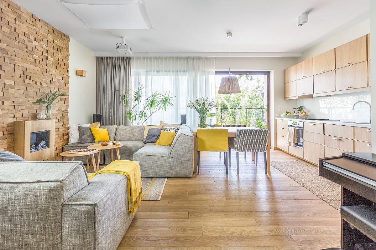 Apartamentul situat într-un bloc nou a fost reconfigurat astfel ca spațiul zonei de zi să fie deschis și funcțiunile să comunice între ele. În zona de zi s-a dorit ca accentul să fie pus pe deschiderea către vegetație, iar ambientul să completeze tot ceea ce este legat de plantele naturale situate pe terasă și dincolod e ea. Schema cromatică adoptată de designer a fost una de alb, lemn, gri și accente de galben pentru senzațe de căldură, de sugestie la zile însorite.