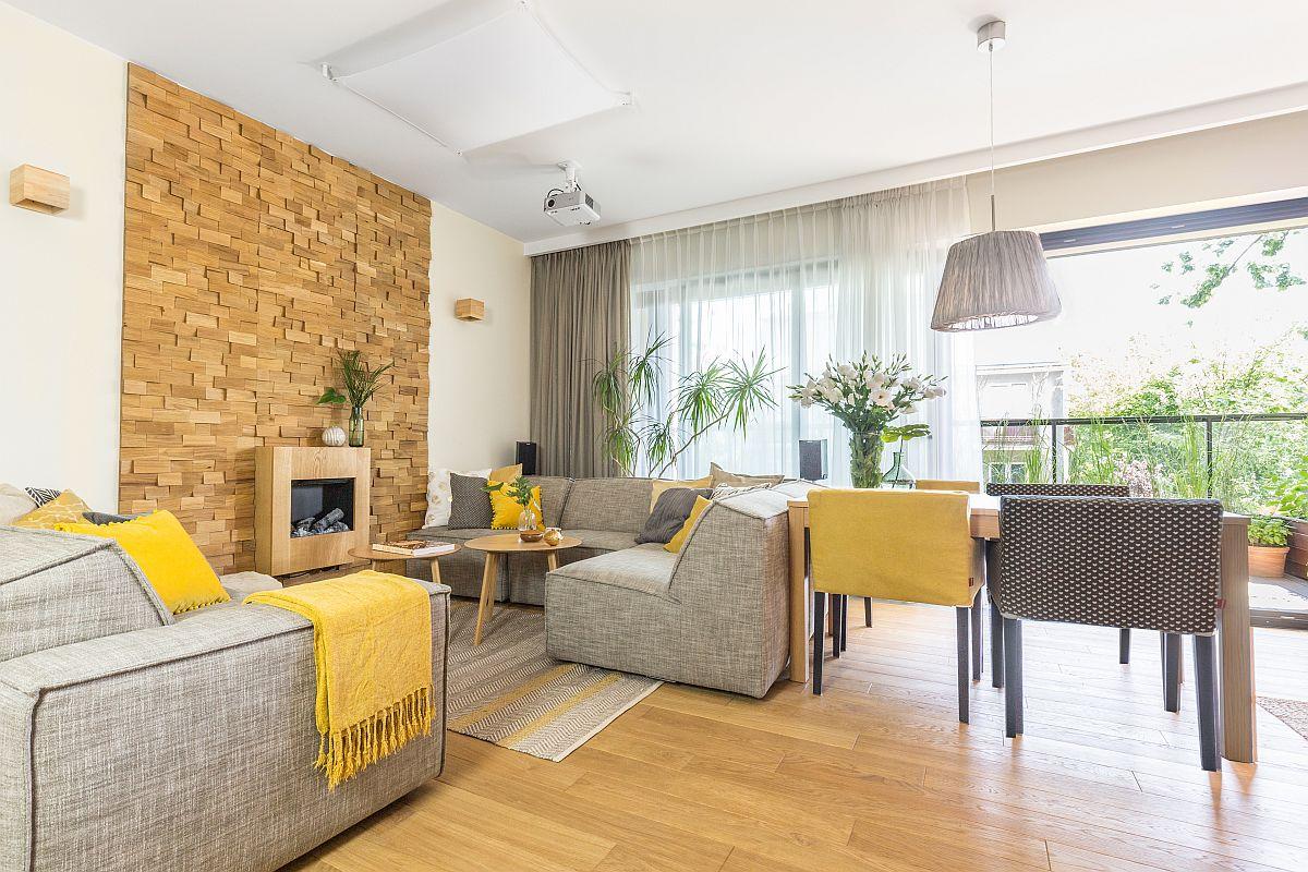 Livingul s-a dorit o încăpere destinată relaxării acasă, de aceea în locul unui tv proprietarii au visat la un șemineu. Designerul a prevăzut astfel o poziționare fața-n față a unor canapele confortabile, iar pe perete o placare 3D din lemn în care este integrat un șemineu cu bioetanol.