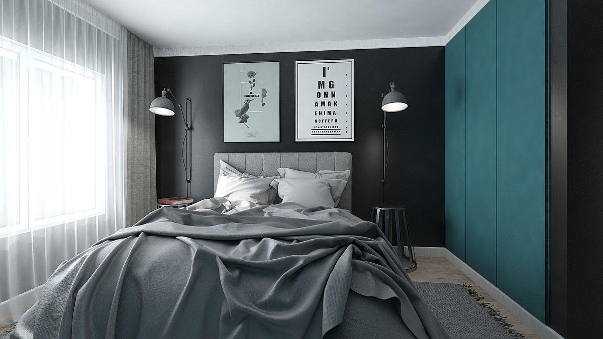 Dormitorul este tratat minimal, iar negrul de pe peretele ce marcehează locul patului vine să confere senzația de adâncime. Dulapul este prevăzut cu fețe într-o nuanță turcoaz pentru a da impresia de placare și nu de prezență a unei piese de mobilier voluminoase.