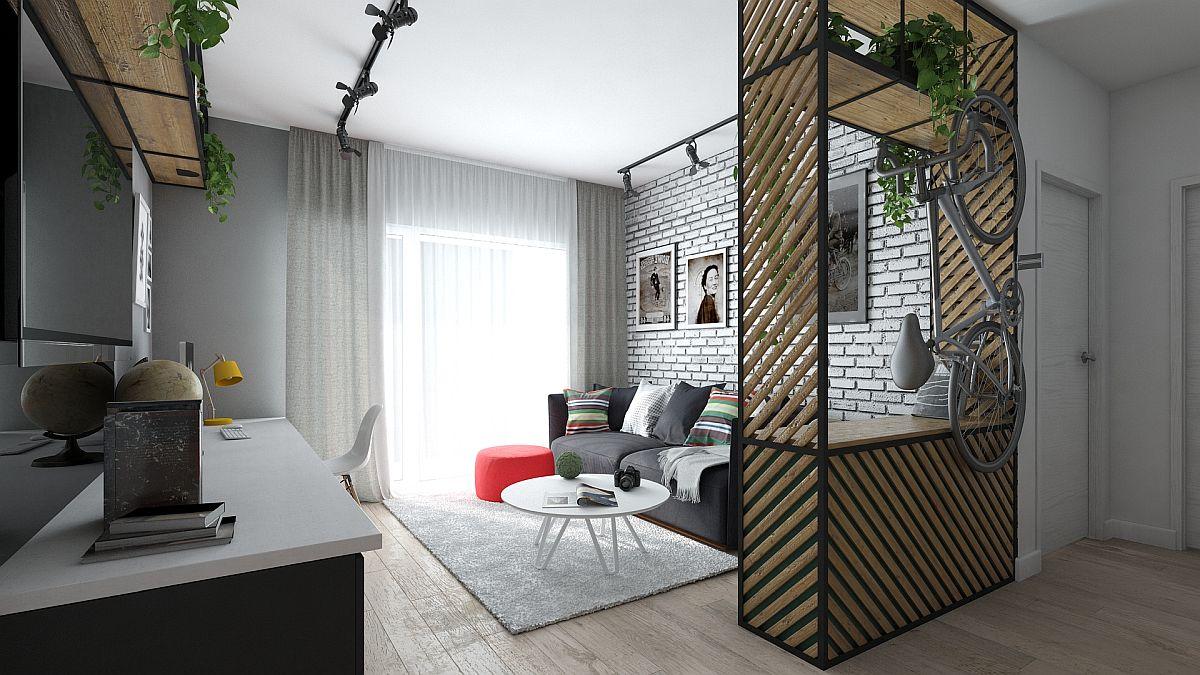 Zona de living a fost delimitată prin structuri metalice cu riflaje. Către hol, piesa de mobilier prevăzută cu structură metalică poate servi și ca suport de bicicletă.