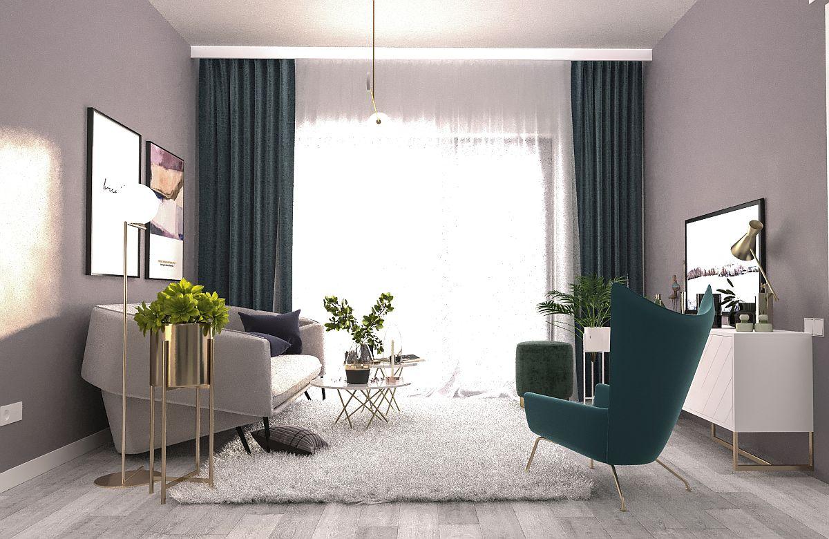 Prin încadrarea cu draperii cu textură de catifea și nuanță de verde, lumina naturală care pătrunde pe fereastra generoasă este și mai bine pusă în evidență. Griurile folosite pentru pereți pun în evidență piesele albe și conferă un aer elegant. Chiar dacă pare prețios, ambientul este unul accesibil ca preț. Diferența o fac accentele de auriu.