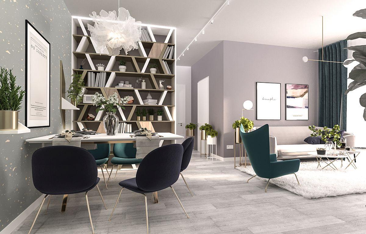 Sufrageria este deschisă către living, unde Laura a prevăzut nuanțe de verde închis pentru tapițeria pieselor de mobilier de accent, nuanță ce se regăsește și la nivelul draperiilor. În rest totul este în tonuri neutre.