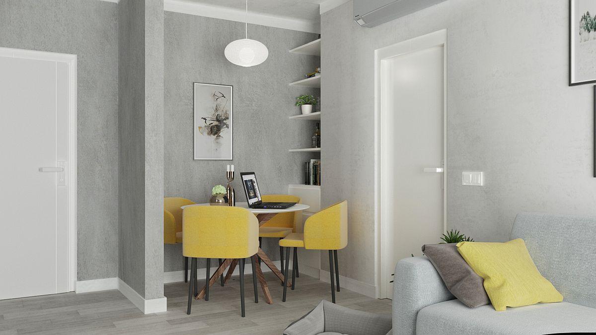 Într-un studio, unde funcțiunile se doresc a fi prezente ca într-un apartament cu mai multe camere, locul de luat masa poate fi folosit fără probleme și ca zonă de lucru la laptop. De aceea, pentru cei care lucrează acasă o bibliotecă aproape prinde bine, iar în partea de jos poate fi depozitare ascunsă, exact în zona în care ar putea să-și bage basul patrupedul.