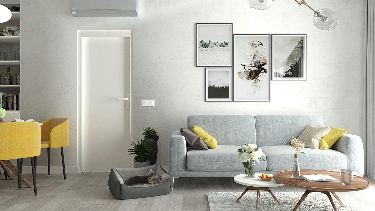 Nuanțe neutre pe suprafețe mari sunt învioare de accente solare, pete de culoare galbene prezente în zona de zi ca pernuțe sau prin tapițeria scaunelor pentru locul de luat masa.