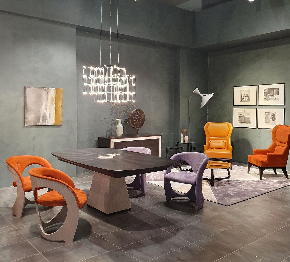 Poți avea pereții și pardoselile în nuanțe neutre, din gama griurilor, dar cu câteva piese de mobilier cu tapițerie portocalie totul devine mai dinamic și mai vesel.