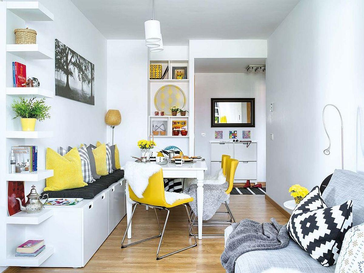Din hol se accende în spațiul livingului, care are o form de L. Imediat la intrarea în cameră, designerii au propus locul de luat masa, fiind cel mai aproape de bucătărie.